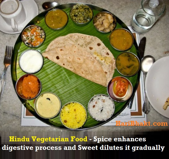 Hindu South Indian Vegetarian Meal consists of sambar, rasam, a kozhambu, kootu, poriyal, pickles and chutneys.